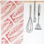 Kitchen Tea Towel with Tunnock's Caramel Wrapper Repeat illustration by Gillian Kyle