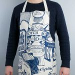Kitchen Tea Towel with Scottish Breakfast design by Gillian Kyle (on model)