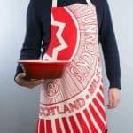 Kitchen Tea Towel with Tunnock's Teacake design by Gillian Kyle (on model)
