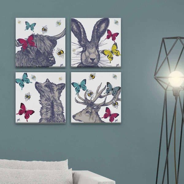 set of 4 canvas prints with Scottish stag, fox, hare and highland cow designs