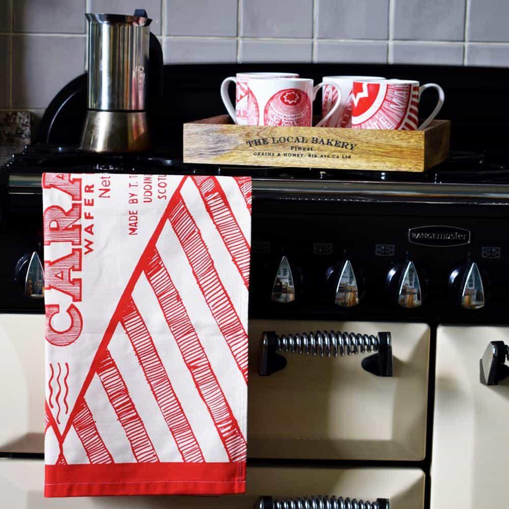 Tunnock's tea cake and caramel wafer mugs and tea towel by Scottish artist Gillian Kyle