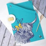 Highland Cow, Butterflies and Bees tea towel by Gillian Kyle